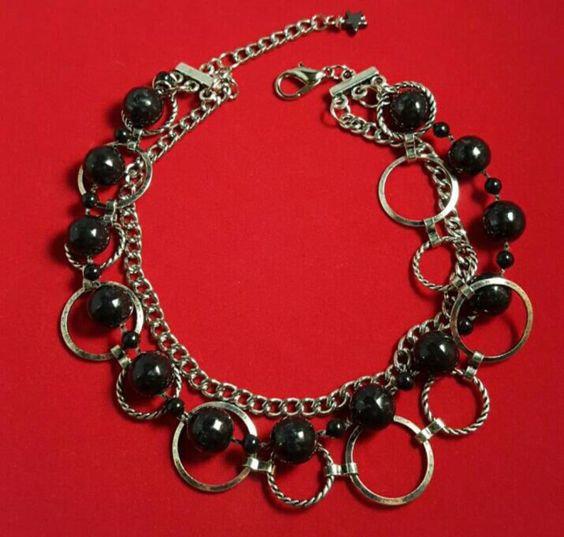 Multi strand statement  bracelet featuring a black bead strand image 0