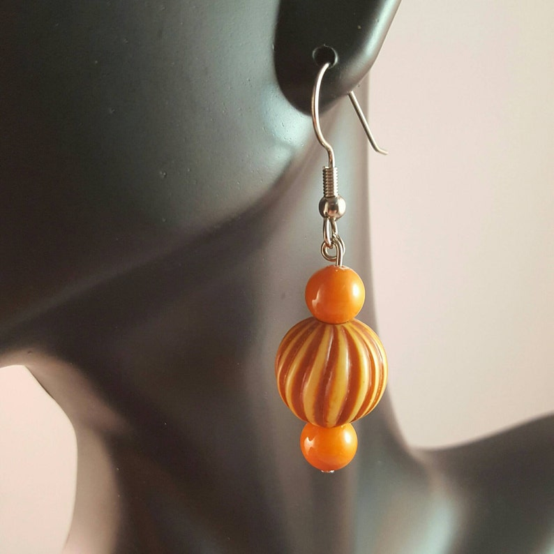 Brown and tan spiral bead dangle earrings accented with small image 0