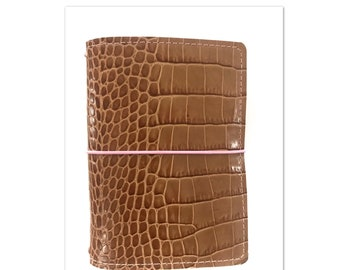 Remy. brown croco embossed leather .