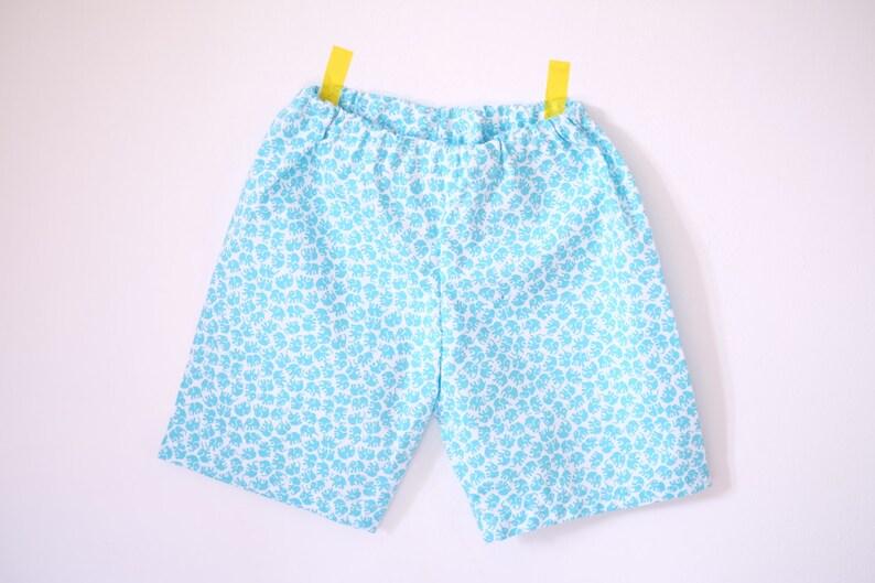 Short  Shorts  elephant print pants  boy flying panda image 0