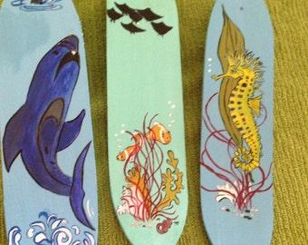 Set of three mini surfboards