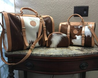 Leather and brown/white cowhide weekender travel bag