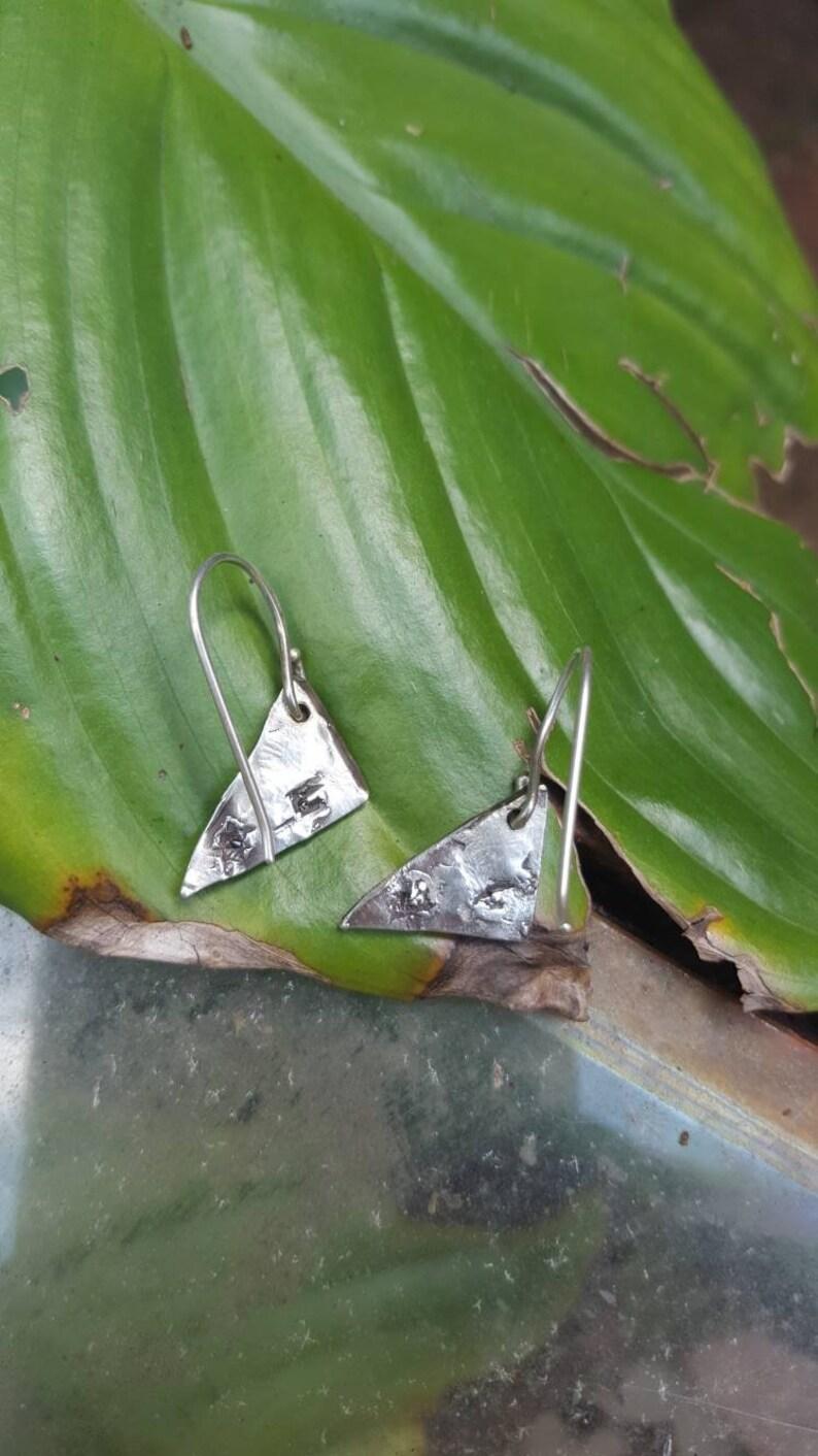 Geometric cast in place earrings