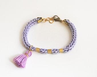 Boho tassel bracelet, Lilac bracelet with tassel charm and tubes, knit cord bracelet, bohemian bracelet