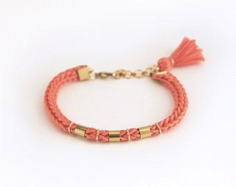 Coral tassel boho bracelet, knit bracelet with tassel charm, coral bracelet