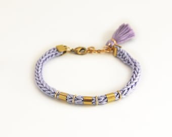 Lavender tassel bracelet for stacking, knit cord bracelet with tassel charm in boho style, lilac and gold