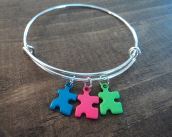 Puzzle piece autism awareness blue pink green charm bangle bracelet