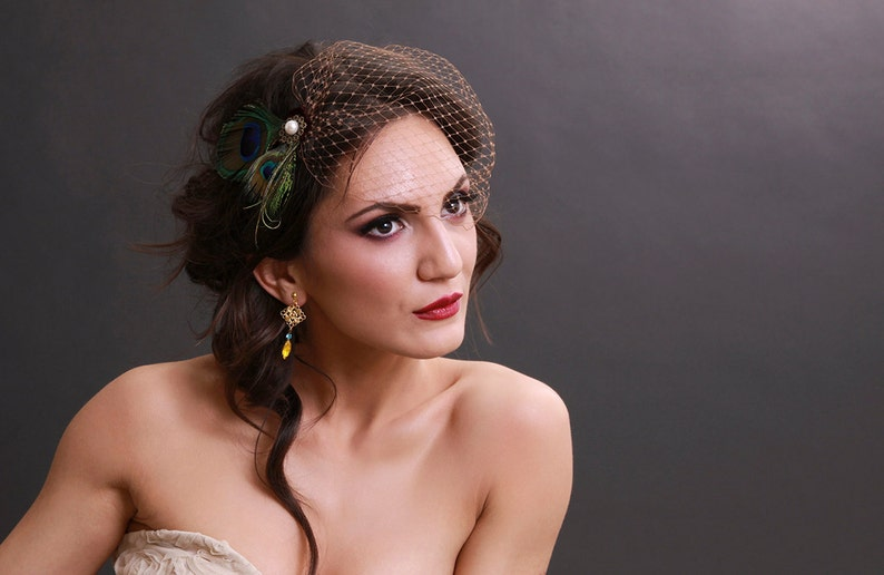 ef9e43ba6263b Peacock feather bandeau birdcage veil with brown french
