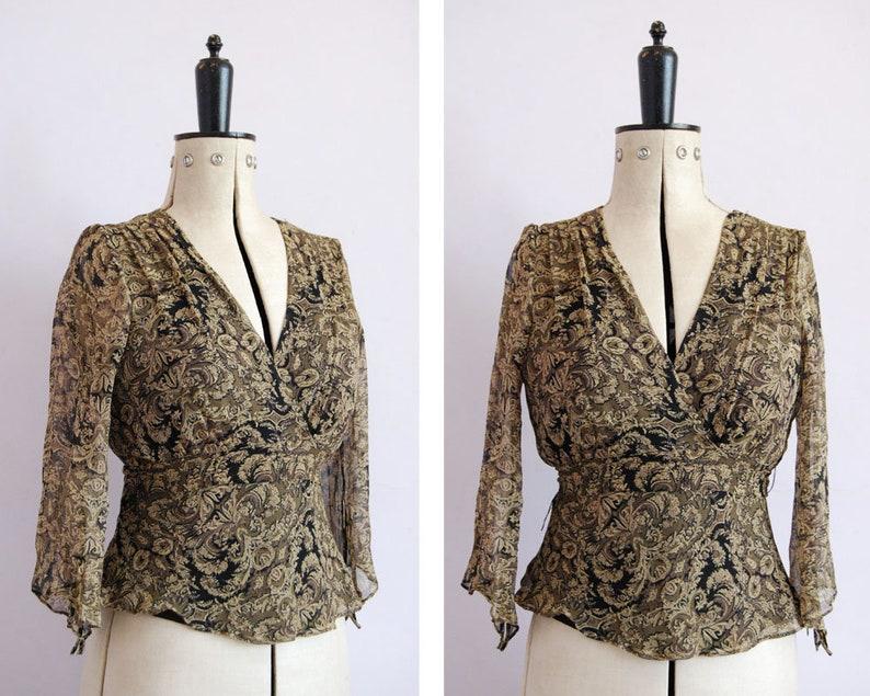 f731371219a4a7 Vintage 90s black   gold floral silk chiffon wrap top blouse