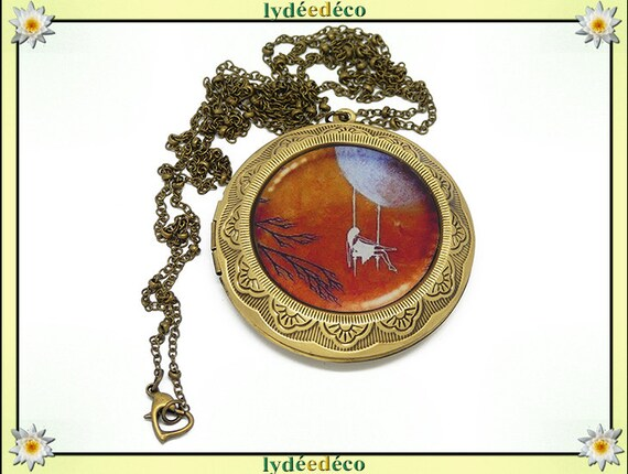 Necklace holder photo retro vintage girl and moon blue camel white resin and brass Locket 45 mm diameter