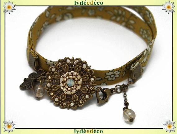 Retro bracelet Pastel print liberty mustard yellow flower beads white Japanese Glass Butterfly brass bronze