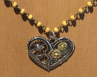 Tan wooden beads, beaded necklace with mechanical heart pendant
