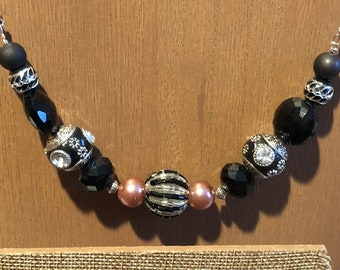 Chunky necklace in black, silver and a touch of pink