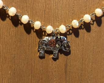 Soft pink beaded necklace with mechanical elephant pendant