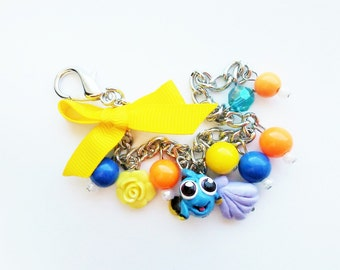 Baby Dory  inspired charm bracelet with a purple shell charm