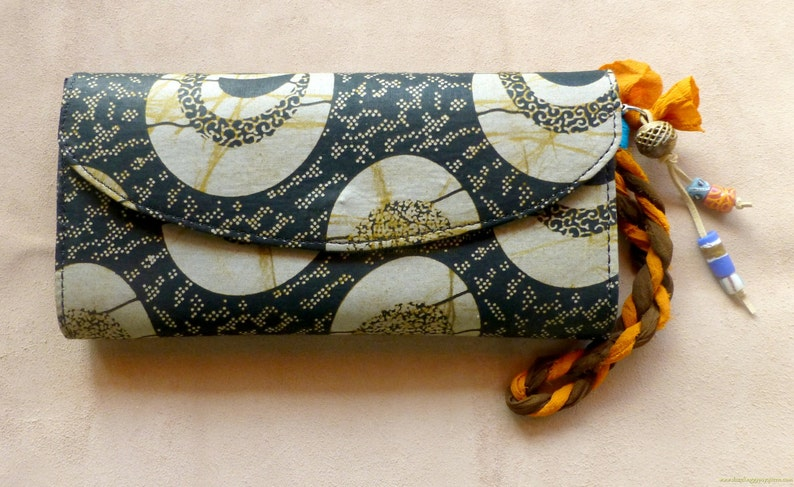 African Wax fabric clutch by Hot Bags  Brown & Orange print  image 0