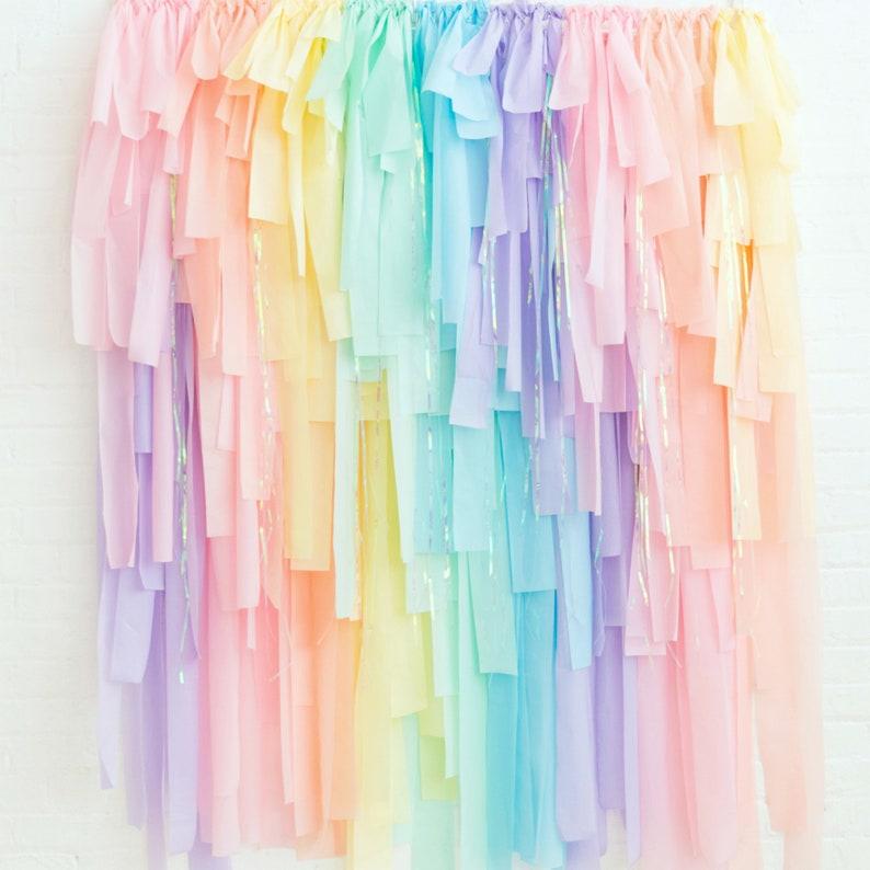 Unicorn Rainbow DIY Streamer Fringe Backdrop Kit. A lovely backdrop for a virtual birthday party. (onestylishparty)