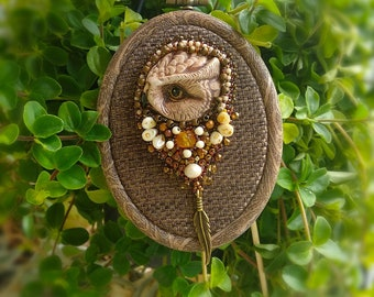 Owl brooch with amber and freshwater pearls.