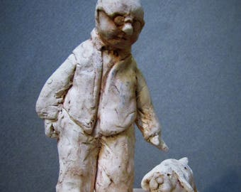By my Side: One of a kind handmade porcelain sculptures of a man and his dog.