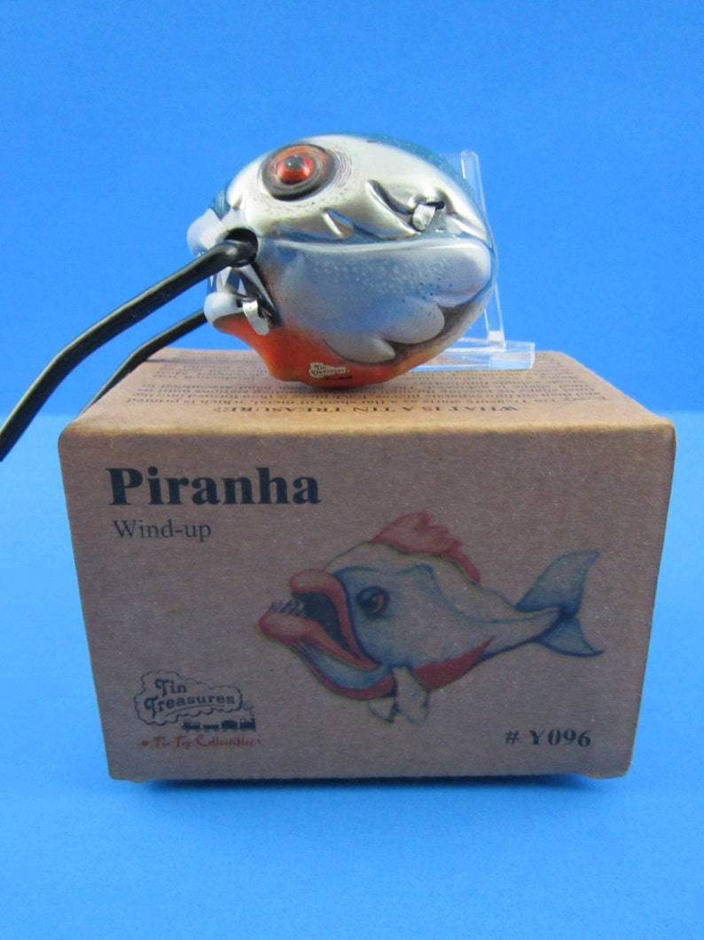 VINTAGE.. Works Great New Old Stock Cats Love Them To.. CRAZY PIRANHA Tin Wind Lithograph Toy Cat Toy  !