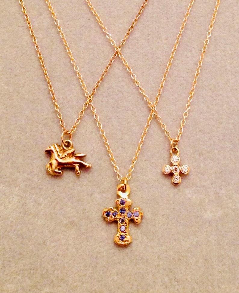 precious tiny little crosses and Pegasus like 14 karat gold Sweet