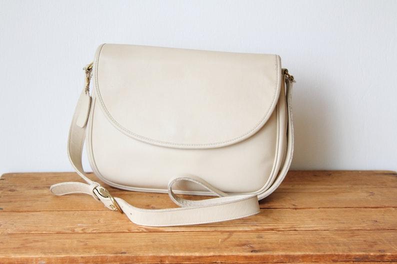 01f3f8011a76 COACH Bone Leather Saddle Bag   Coach Cream Leather Flap