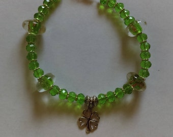 Green bracelet with 4 leaf clover charm