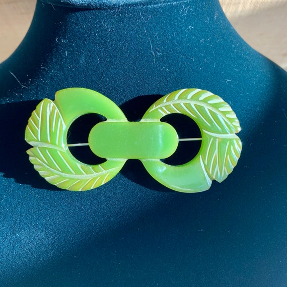 1940s green Bakelite carved brooch