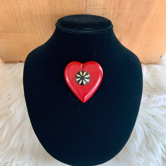 1940s Red Bakelite heart with black carved center