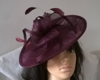 Stunning Claret Sinamay Shaped disc Fascinator with swirls,loops & coque feathers..wedding,races
