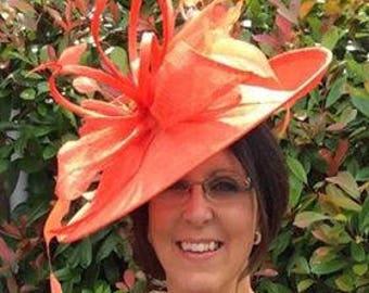 Lyndsey..Orange large Hatinator Sinamay and feathers on a Headband.