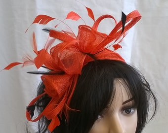Stunning Orange rosette Sinamay and  Feather Fascinator..on a headband with Black