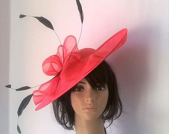 d17a66a5 Elegant shaped hatinator in bright coral with Bow & feather trim .