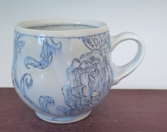 Handmade porcelain mug with blue and white floral toile pattern
