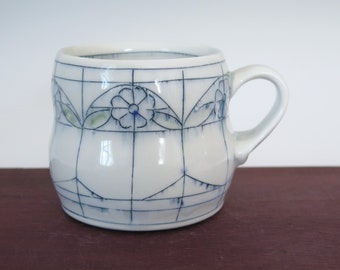 Handmade porcelain mug with stained glass window floral pattern