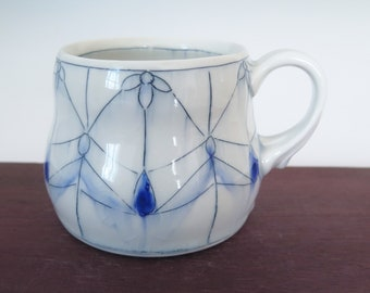 Handmade porcelain mug with stained glass window pattern