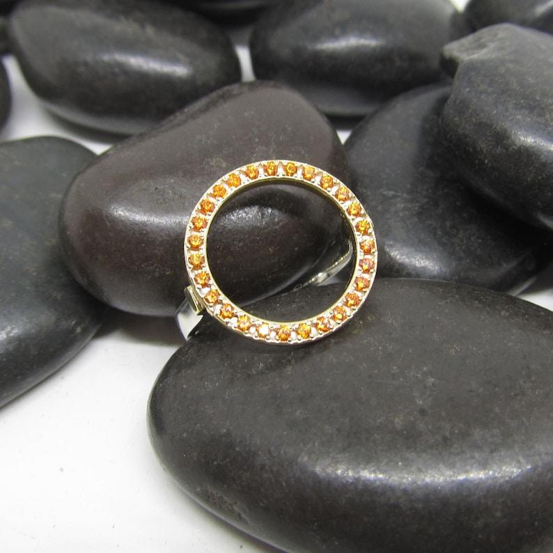 Silver orange ring by Antonis Xenakis  Greece  Greek  designer  zircon  sun  light  handmade