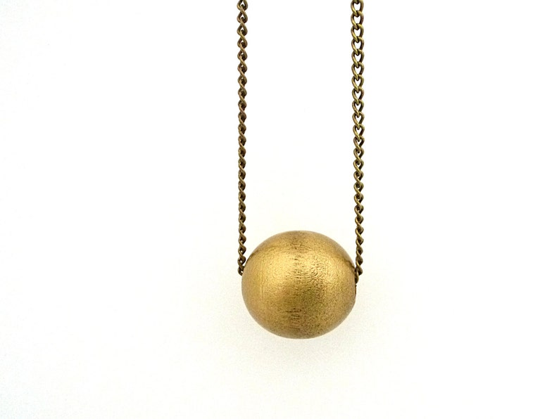 Gold bead necklace wooden bead necklace brass chain single image 0