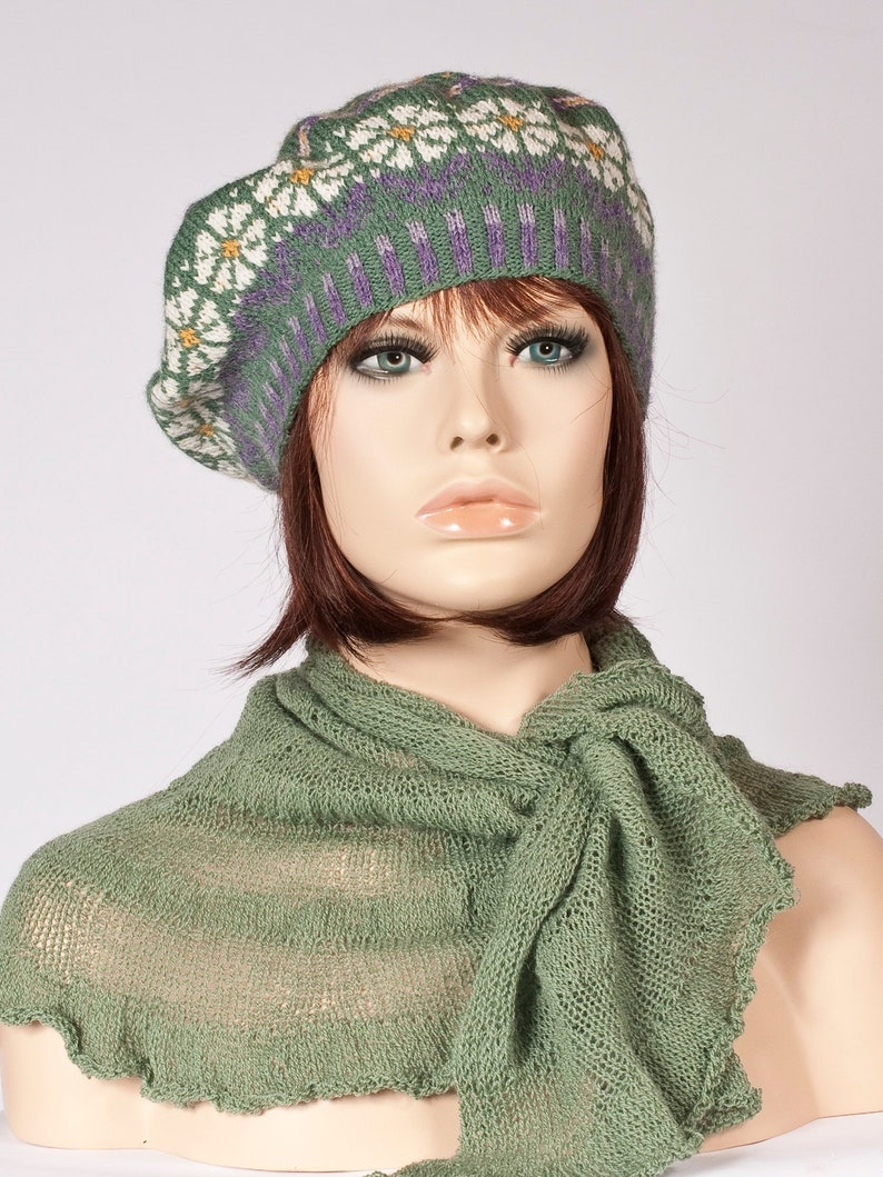 4330585537bd8 Hand knitted green beret with white yellow purple motif of