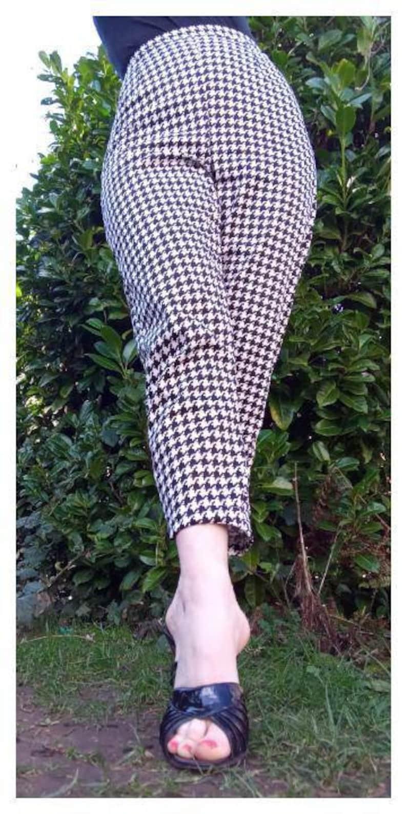 1950s Pants & Jeans- High Waist, Wide Leg, Capri, Pedal Pushers Vintage 1950s 1960s style hounds tooth cigarette pants long Capri trousers black and white $72.51 AT vintagedancer.com