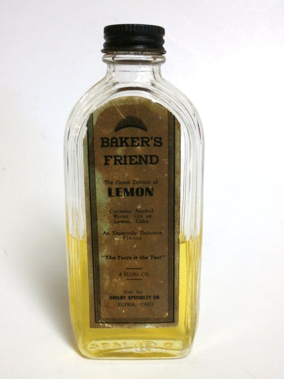 Vintage Baker's Friend Lemon Extract Bottle     Circa 1940's    Contains Extract