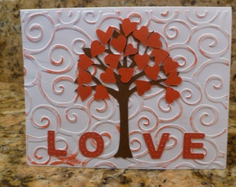 LOVE heart tree, with embossed background and tiny red hearts covering tree.