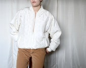 white silk quilted bomber jacket