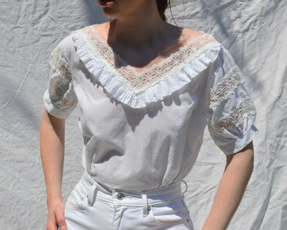 white cotton puff sleeve with button back