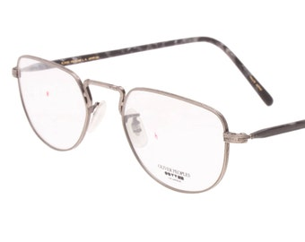c92f5ba9b3279 Oliver Peoples OP45 1980s NOS oval beautifully carved with fine details  silver metal spectacle frames with grey tortoise cello temples