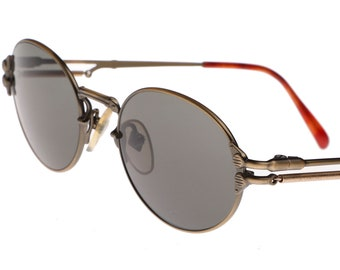 ecb0c5058a7cd Jean Paul Gaultier oval antique brass steampunk sunglasses with outstanding  active spring temple design