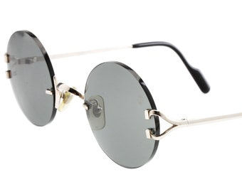 df454e0546b Cartier Madison platine round sunglasses