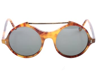 1ea09d096ec Gianni Versace vintage 80s round tortoise cool and hype sunglasses