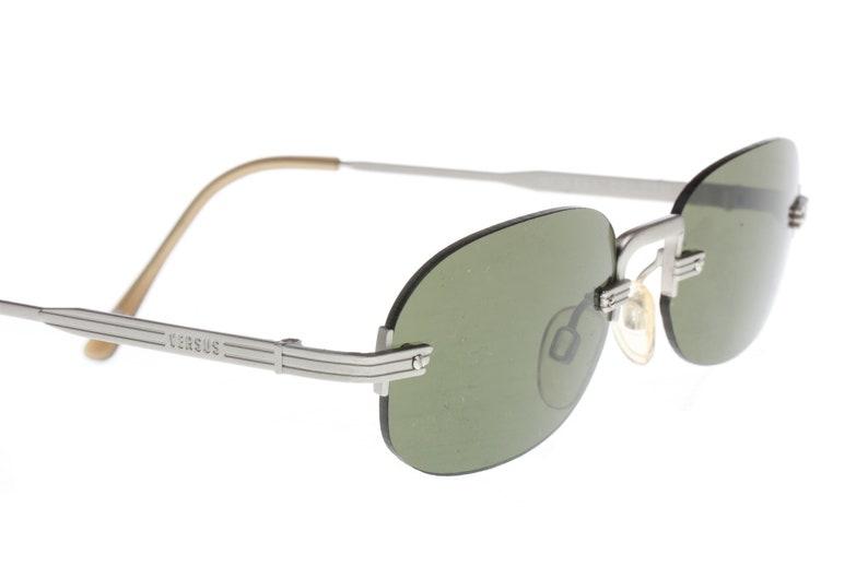 74642ca625a2 Gianni Versace Versus modernist squared rimless sunglasses