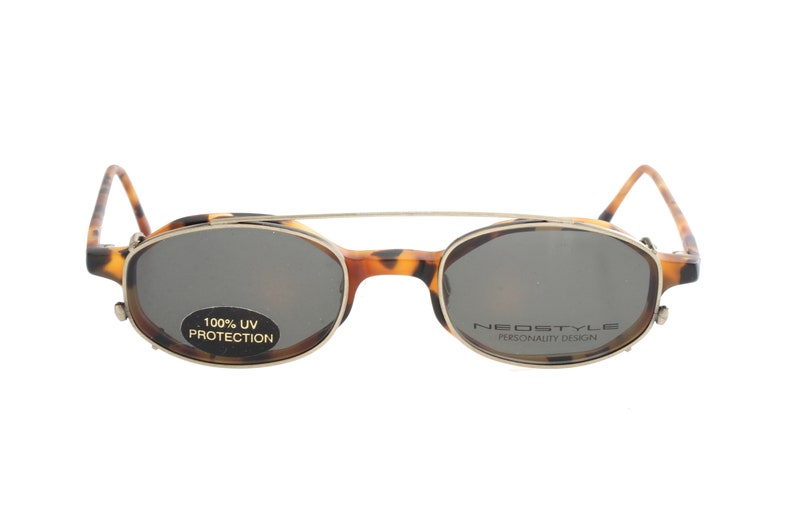 ab4d7624b63 Neostyle College 90s oval eyeglasses with sunglasses clip on
